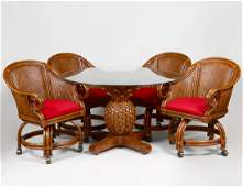 GLASS TOP PINEAPPLE BASE TABLE AND FOUR ARMCHAIRS