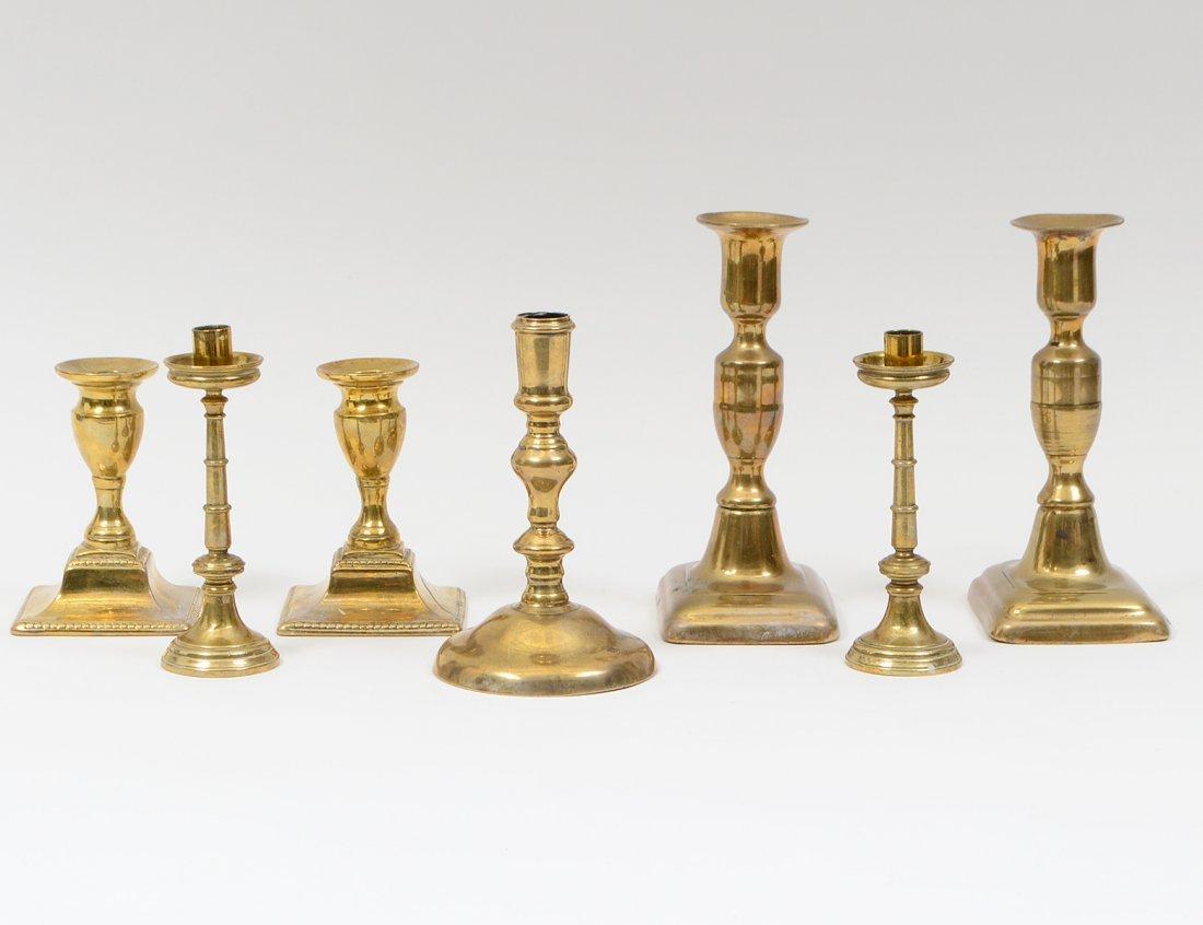 GROUP OF SEVEN BRASS CANDLESTICKS