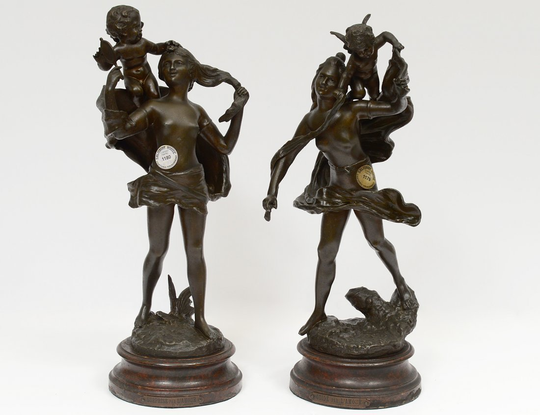 PAIR OF PATINATED WHITE METAL FIGURAL GROUPS