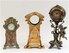 TWO EARLY 20TH CENTURY GILT METAL TABLE CLOCKS