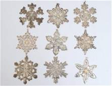 GROUP OF NINE STERLING SILVER ORNAMENTS