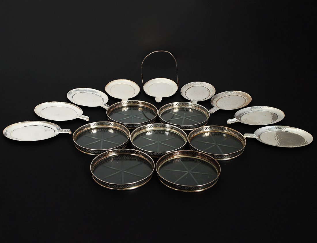 SET OF EIGHT HAND HAMMERED STERLING SILVER ASHTRAYS