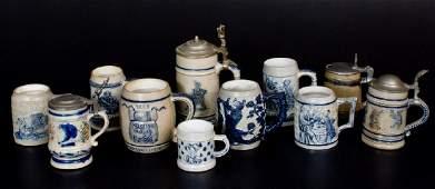 Eleven CobaltDecorated Stoneware Mugs mostly Whites