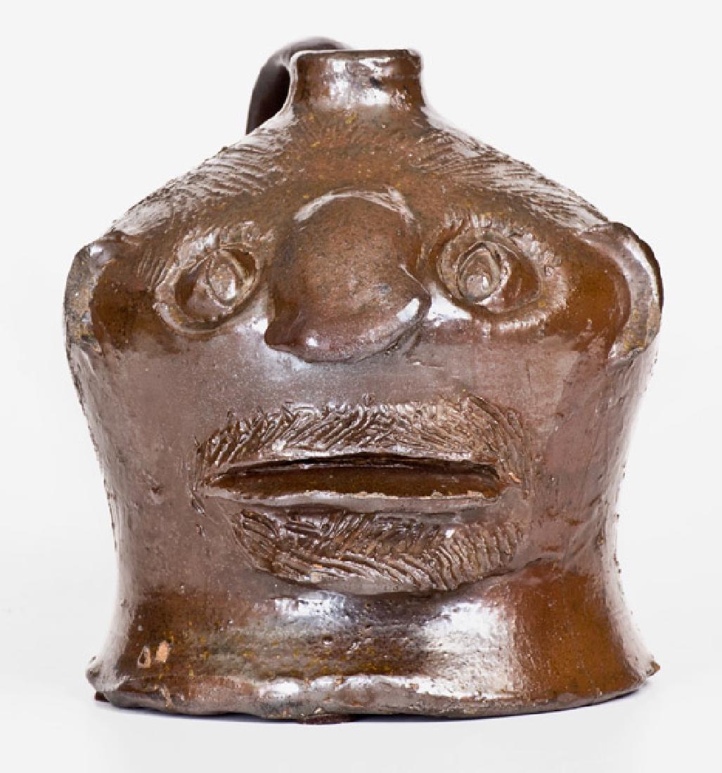 Rare and Fine Stoneware Face Jug att. Charles P.