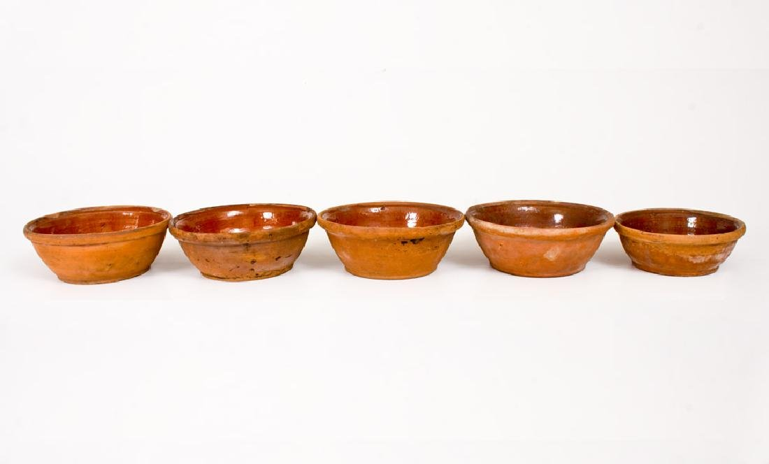 "Lot of Five: Redware Bowls (One Inscribed ""Mended""),"