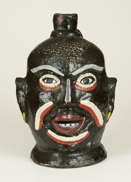 Very Rare Cold Painted Face Jug with Elaborate Speckled