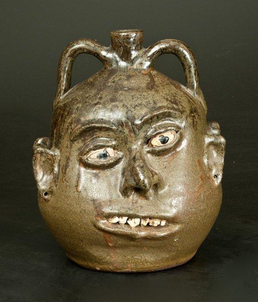 Rare Alkaline-Glazed Stoneware Double Face Jug, Signed