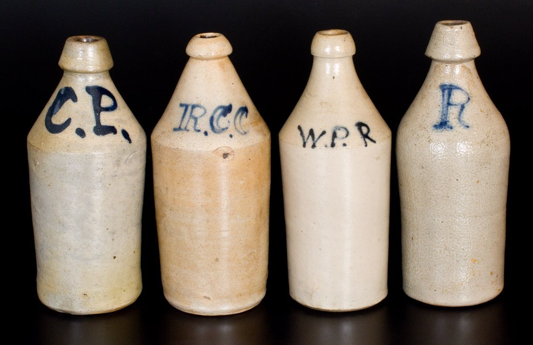 Lot of Four: Stoneware Bottles with Slip-Trailed Cobalt
