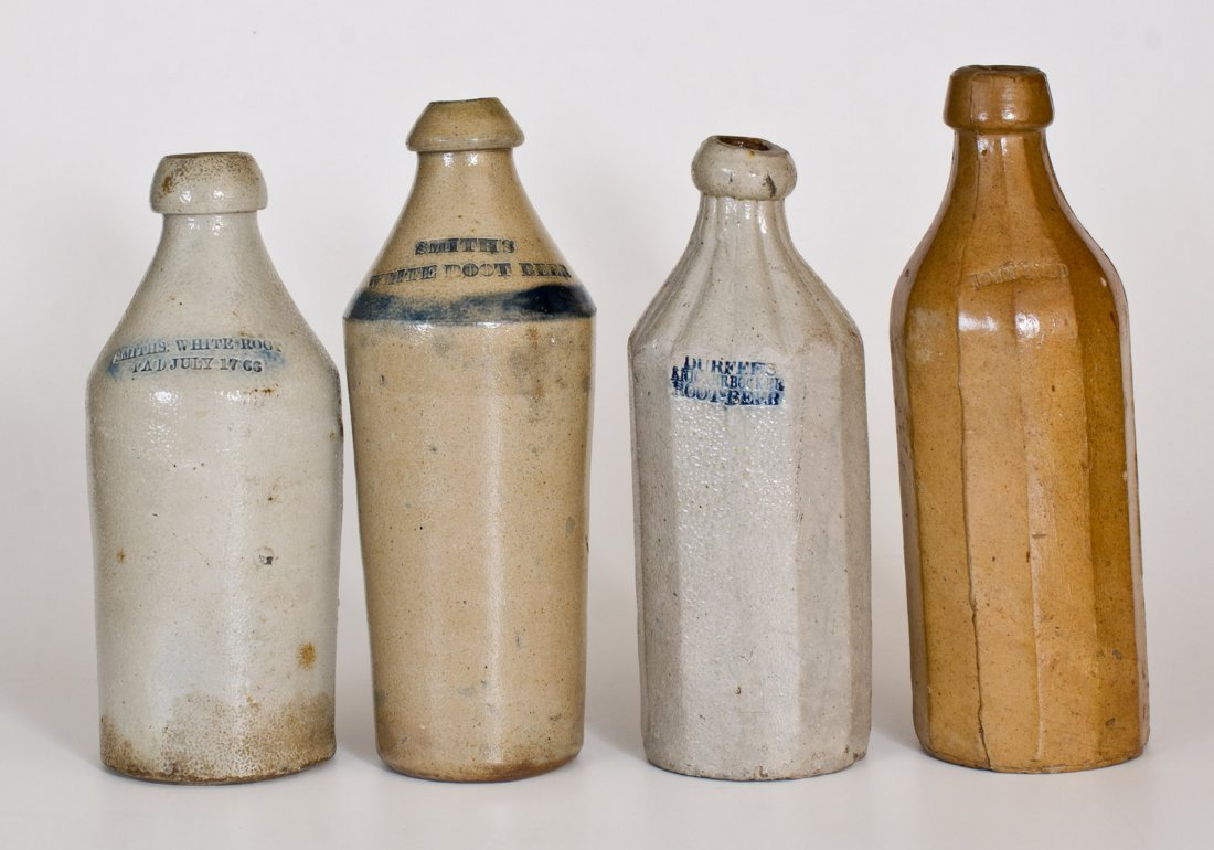 Lot of Four: Stoneware Bottles with Impressed