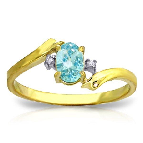 14K YG 0.01ct DIAMONDS & 0.45ct OVAL BLUE TOPAZ RING