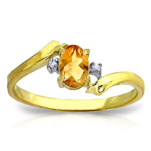 14K Y.GOLD 0.01ct DIAMOND & 0.45ct OVAL CITRINE RING
