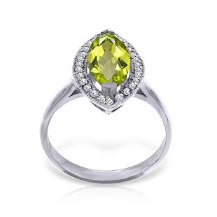 14K. SOLID GOLD RING WITH DIAMONDS & MARQUIS PERIDOT