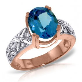 14k Rose Gold Sounds Within Blue Topaz Diamond Ring
