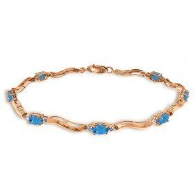 14k Rose Gold Tennis Bracelet W/ Diamonds & Blue Topaz