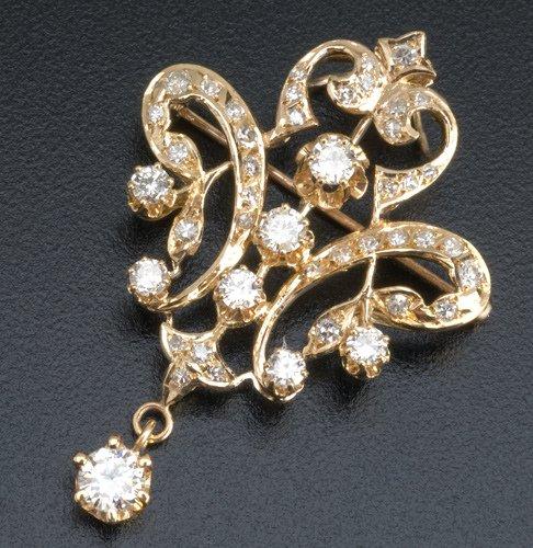 79: Shield-form diamond brooch in 14k yg, 20th C.