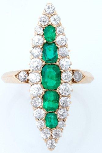 81: Diamond and emerald navette ring in 14k yg.