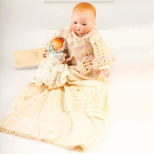 11: Two dolls: bisque baby, Made in Japan, with turned