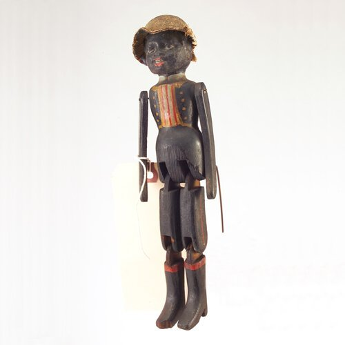 24: Carved Black Folk Art doll with painted-on soldier