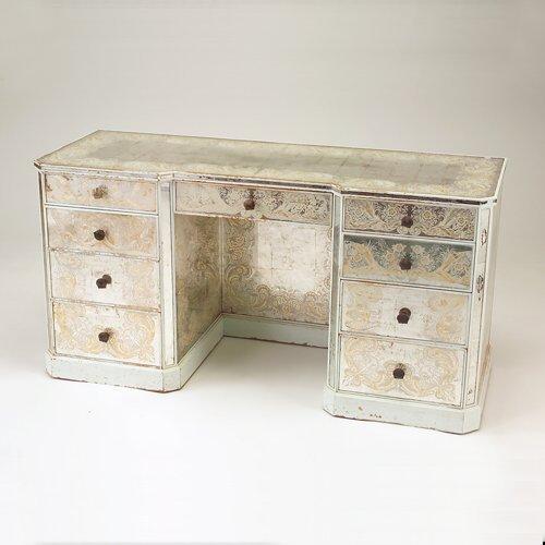 784: Glass-encased silver leaf vanity with nine drawers