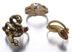 36 Three gold serpent rings coiled serpent in 14K wit