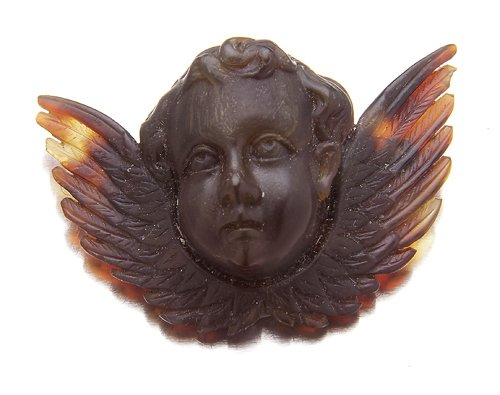 123: Victorian cherub brooch, carved tortoise shell, 50