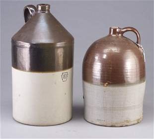 Two large stoneware two-tone jugs, one mar