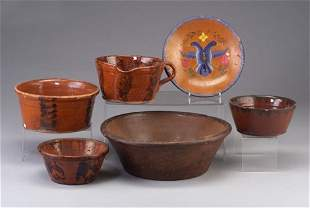Six pieces of redware including basin, thr