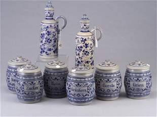 Set of six German stoneware canisters and