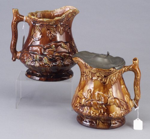 18: Two Rockingham huntjugs, one with pewter