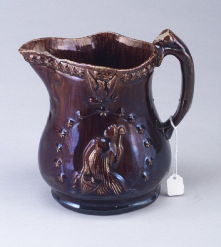 19: Bennington USA-type jug, some chips.