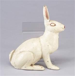 Cast iron rabbit door stop, enameled whit