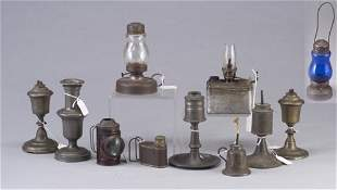 Eleven pewter and tin lamps including sma