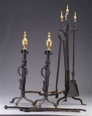 Pair of wrought iron andirons with brass
