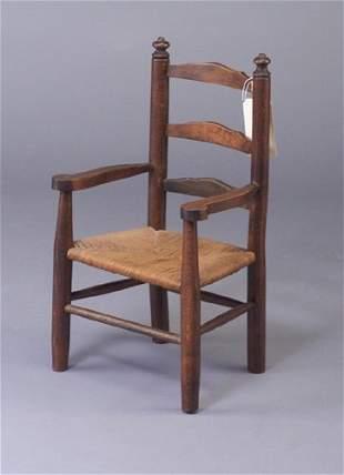 Ladderback rush-seat child's chair. 25 1/