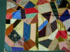 88 Pieced crazy quilt top in mixed satin ve