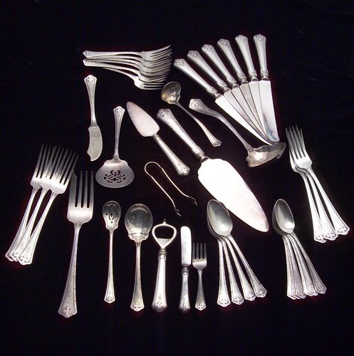 16: Sterling flatware 39 pieces with hammered edge and