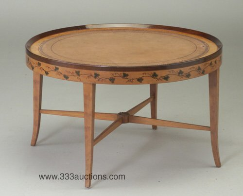 509: Circular coffee table attributed to Jose