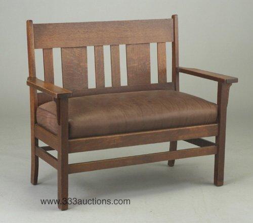 592: Arts & Crafts drop-arm settee with slatt