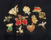 Eleven fanciful vintage costume brooches