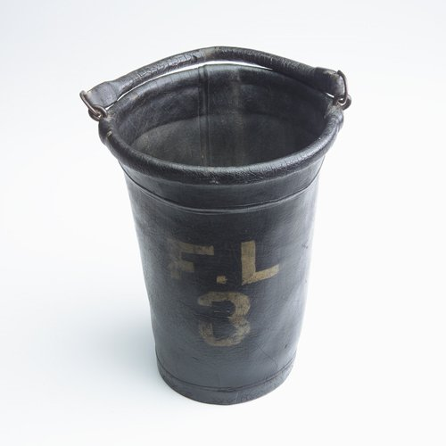 7: American leather fire bucket with over varnish. Orig
