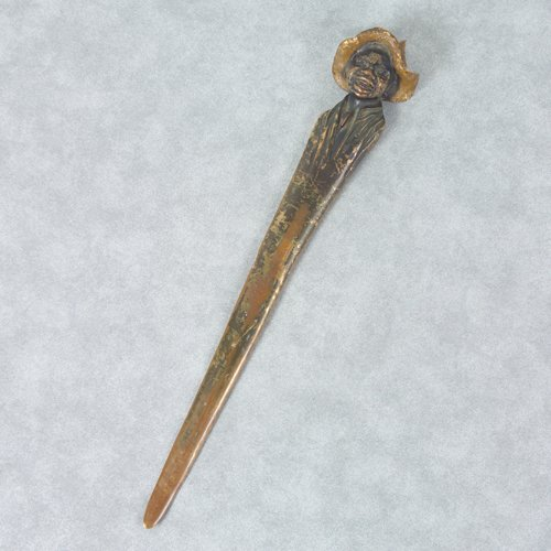 9: Bronze letter opener in the form of a laughing Afric