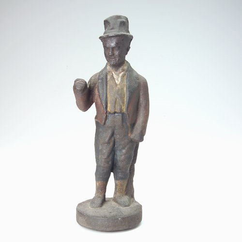 10: Cast-iron figure of a man dressed in coat and tail