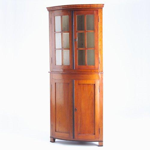 16: Biedermeier-style bowfront corner cupboard in two-o