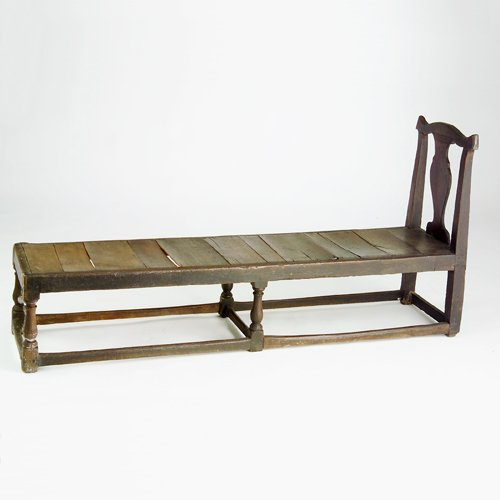 18: English daybed with raised back and plank seat, on