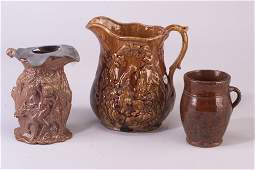 143: Three vessels: Rockingham pitcher with e