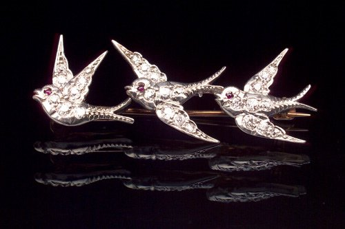 8: J. E. CALDWELL Swallow brooch with diamonds in plati
