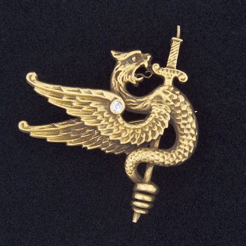 21: ART NOUVEAU Winged serpent and sword brooch in 14k