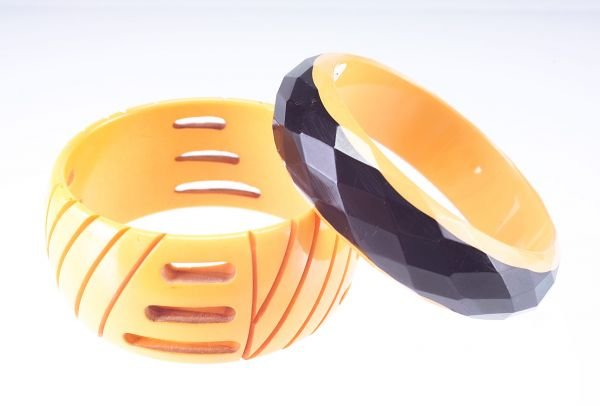 3: Two bakelite bangles, one tan with incised and pierc