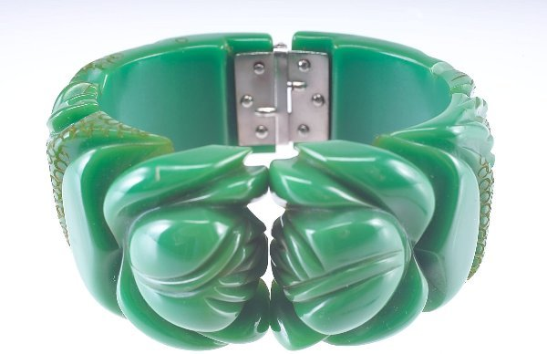 7: Hinged bakelite bangle, green with deeply-carved sty