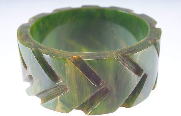 10: Wide green bakelite bangle deeply-carved with bold